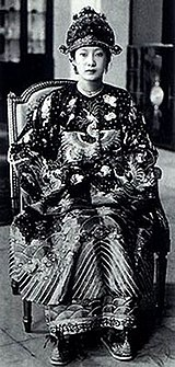 Empress Nam Phuong in a formal court gown.