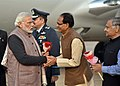 Narendra Modi being welcomed by the Chief Minister of Madhya Pradesh, Shri Shivraj Singh Chouhan, on his arrival at Gwalior to attend the Annual Conference of DGPs and IGPs, at the BSF Academy, Tekanpur, Madhya Pradesh.jpg