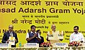 "Narendra Modi releasing the brochure at the launch of the ""Saansad Adarsh Gram Yojana"", in New Delhi. The Union Minister of Rural Development, Drinking Water & Sanitation, Panchayati Raj, Shipping.jpg"