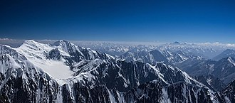 Badakhshan Province - Noshaq (or Nowshak) (Dari: نوشاخ) is the second highest independent peak of the Hindu Kush Range after Tirich Mir (7,492 m (24,580 ft)). It lies on the border between Badakhshan Province in Afghanistan and Pakistan. The north and west sides of the mountain are in Afghanistan whereas the south and eastern sides are in Pakistan. Noshaq is Afghanistan's highest mountain and is in the northeastern corner of the country along the Durand line (which marks the border with Pakistan). It is the westernmost 7000m peak in the world.