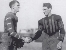 Two football players, shaking hands