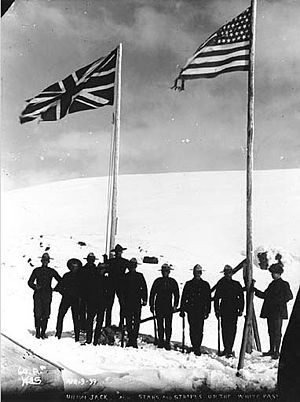 Union Jack - 1899 photograph of the British and American flags on the border between British Columbia and Alaska