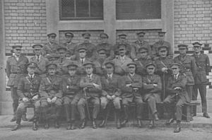 Formal group portrait of men in Army uniform