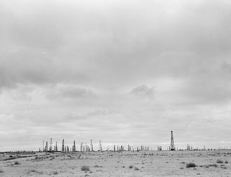 Oil field in California, 1938. The first modern oil well was drilled in 1848 by Russian engineer F.N. Semyonov, on the Apsheron Peninsula north-east of Baku. Oilfields California.jpg