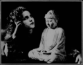 Olive Thomas and a statue of the Buddha.png
