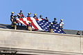 On the roof, a crew of military and civilian members prepare to unfurl a Garrison Flag, the largest authorized for the military, near the damaged area of the Pentagon's east wall 010912-D-IW690-011.jpg