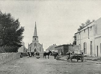 Fraserburg - A photograph down the main road running from Leeu Gamka of the old Dutch Reformed Church in 1899.