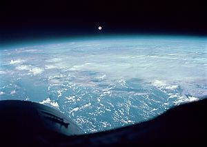 Gemini 7 - Moon and clouds over the Western Pacific as seen from Gemini 7