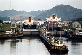 Panamax - Two ships seen almost touching the walls of the Miraflores Locks.
