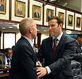 Paul Renner is congratulated on the House floor by Chris Sprowls.jpg