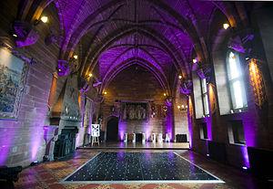 Peckforton Castle - A formal room set up for a wedding reception