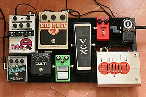 Vintage musical equipment - A guitar pedal board comprising several effects pedals, including vintage Electro-Harmonix Big Muff and  Vox wah-wah pedals from the 1960s and 70s.