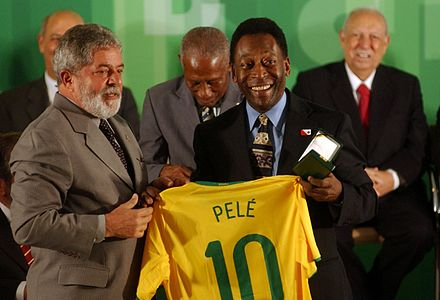Brazil President Lula and Pele in commemoration of 50 years since the first World Cup title won by Brazil in 1958, at the Palacio do Planalto, 2008 Pele & Lula.jpg