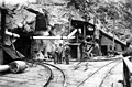 People at Great Northern Railway Eight-Mile Tunnel portal (now the Cascade Tunnel) in the Cascade Mountains, 1925 (TRANSPORT 1563).jpg
