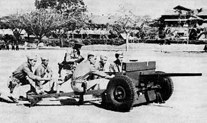 United States Army Forces in the Far East - Philippine Scouts being trained at Fort William McKinley on a 37 mm (M3) anti-tank gun.