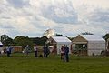 Pickmere telescope in the background of the Cheshire Game and Country Fair 2014.jpg