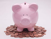Piggy Bank On Pennies (5915295831).jpg