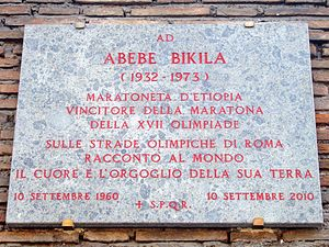 A plaque on a wall in Rome, describing Abebe's victory