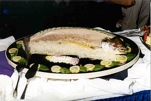 English: A poached Salmon on ice with a garnis...