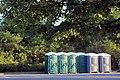 Portapotties in park among trees.jpg