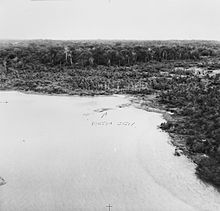"An aerial photograph showing a cleared area of beach, with the words ""Porton jetty"" labelled in pencil with an arrow."