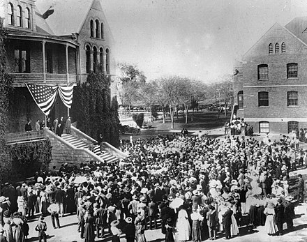 President Theodore Roosevelt addresses a crowd of students on the steps of the Old Main at Tempe Normal School (future Arizona State University), March 20, 1911. Pres. Theodore Roosevelt at Old Main of Arizona State University.jpg