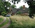 Pretty thatched cottage between Gunton and Hanworth - geograph.org.uk - 509980.jpg