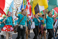 Pride in London 2016 - Young flag bearers including one with a whistle in the parade.png