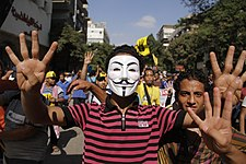 Protester with Guy Fawkes mask making R4bia sign Maadi-Cairo 20-Sep-2013.jpg