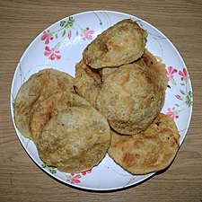 Puri (food), fried dough food at Wikipedia's 16th Birthday celebration in Chittagong (01).jpg