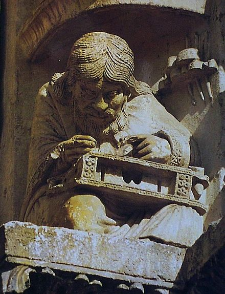 Pythagoras appears in a relief sculpture on one of the archivolts over the right door of the west portal at Chartres Cathedral. Pythagore-chartres.jpg