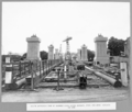 Queensland State Archives 3695 South approach end of hammer head crane runway steel for span 1 stacked on site Brisbane 1 September 1936.png