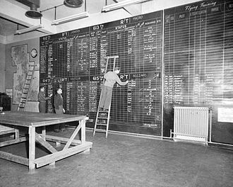 RAF Deenethorpe -  An airman of the 401st Bomb Group updates the operations board. 13 January 1945.