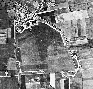RAF Kirton in Lindsey - Aerial photograph of RAF Kirton in Lindsey showing, the technical site with three C-Type hangars to the top (north), 27 July 1948.