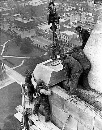 "Canada Life Building - ""Raising the last stone"": The Canada Life building under construction in 1930"
