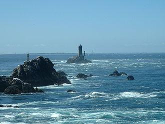 Île de Sein - La Vieille lighthouse on the Raz de Sein; the island in the background