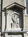 Relief an der Wand der Stadtpfarrkirche St. Gallus - Bregenz.JPG