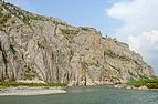 Rock face overlooking Firth River at Muskeg Creek confluence, Ivavvik National Park, YT.jpg