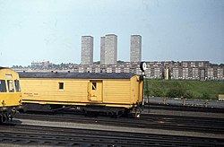 Rolling stock at Springburn, with Red Road Flats in the background (geograph 4156676).jpg