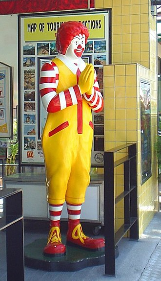 """Ronald McDonald - A Ronald McDonald statue in Thailand greeting guests with the traditional Thai """"wai"""" greeting"""