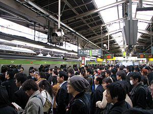 Commuting - Rush hour at Shinjuku Station, Tokyo