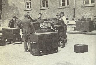 """Fish (cryptography) - German prisoners prepare the """"Russian Fish"""" for loading and shipment to England."""