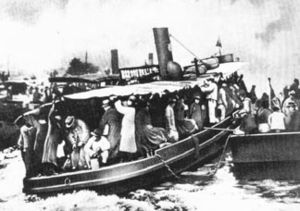 Shanghai Russians - A group of Russian émigrés arriving in Shanghai. A photograph from the newspaper Shankhaiskaya zarya, 23 February 1930.