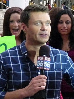 English: Ryan Seacrest tapes a promo with some...