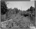 SIDE VIEW; FLUME EMPTYING INTO FOREBAY LAKE-1980 - Power Flume No. 1, Tacoma, La Plata County, CO HAER COLO,33-TAC.V,3-20.tif