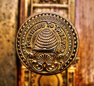 "Temple (LDS Church) - A doorknob of the Salt Lake Temple bearing an image of a beehive and carrying the inscription, ""Holiness to the Lord"""