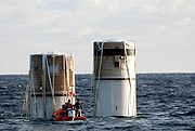 The solid rocket boosters, jettisoned from the Space Shuttle Discovery following the launch of STS-116, floating in the Atlantic Ocean about 150 miles north east of Cape Canaveral.