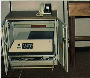 STU-II - STU-II cabinet with desk set on top.