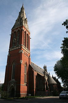 Red brick church with tall spire