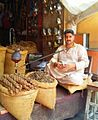 Salesman in Delhi Gate Lahore, Selling fig and smoking traditional 'Huqa'.jpg